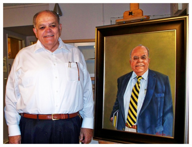 Donald S. Fortner beside his portrait